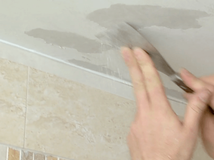 Image result for scrape wall and apply solution in bathroom