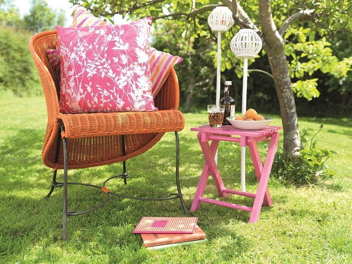if youre short on space but want to brighten up your garden adding furniture in bold colours can make up for the lack of natural colour